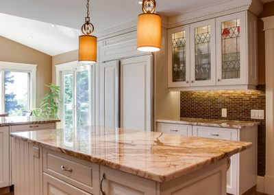 kitchen renovation with white cabinets and quart counter tops