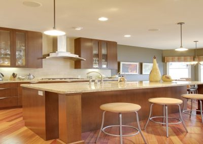 Kitchen renovation with large island and bar seating