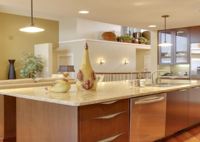 kitchen renovation with large white granite island and custom sliding wooden drawers