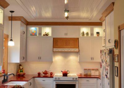 Farmhouse kitchen renovation with white wooden ceiling