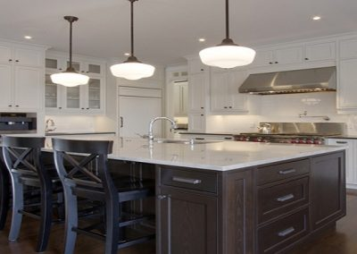 Open concept kitchen with large island with white countertops