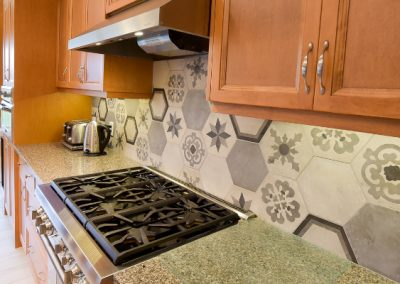 Hexagon kitchen backsplash with intricate designs