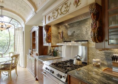 Exquisite kitchen renovation with arched ceilings and granite countertops