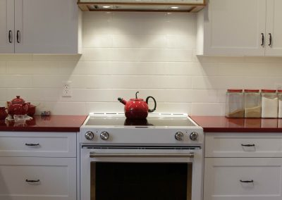 White farmhouse kitchen and red countertops