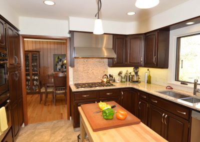 Dark cherry wood cabinets in kitchen renovation