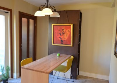 Small kitchen space with narrow wooden kitchen table