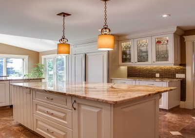 two light island pendant hanging above quart island counter top