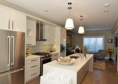 Show home kitchen renovation with long island throughout kitchen