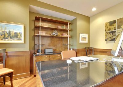 Home office with large granite desk